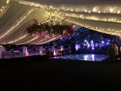 Suspended flower ring in marquee roof westernmarquees.co.uk